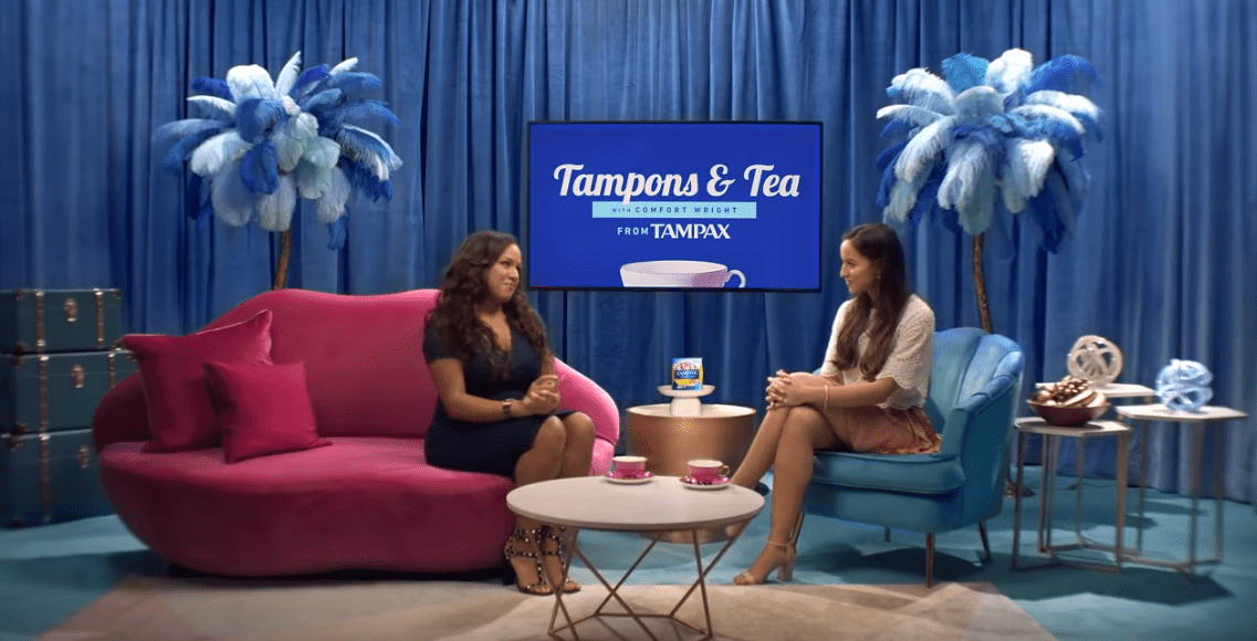 Shot of the tampax ad where two women disucss tampons