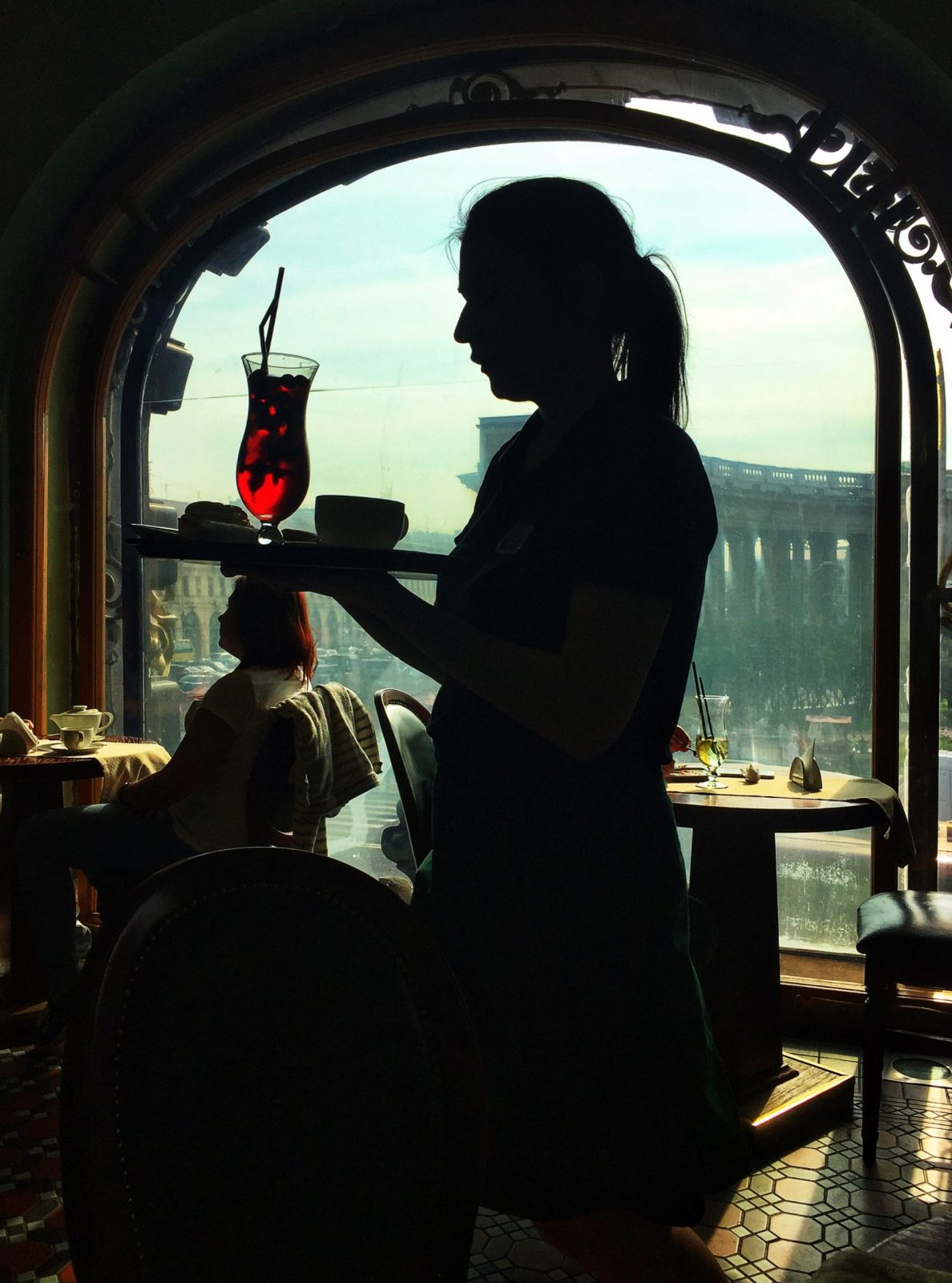 a waitress in a European cafe