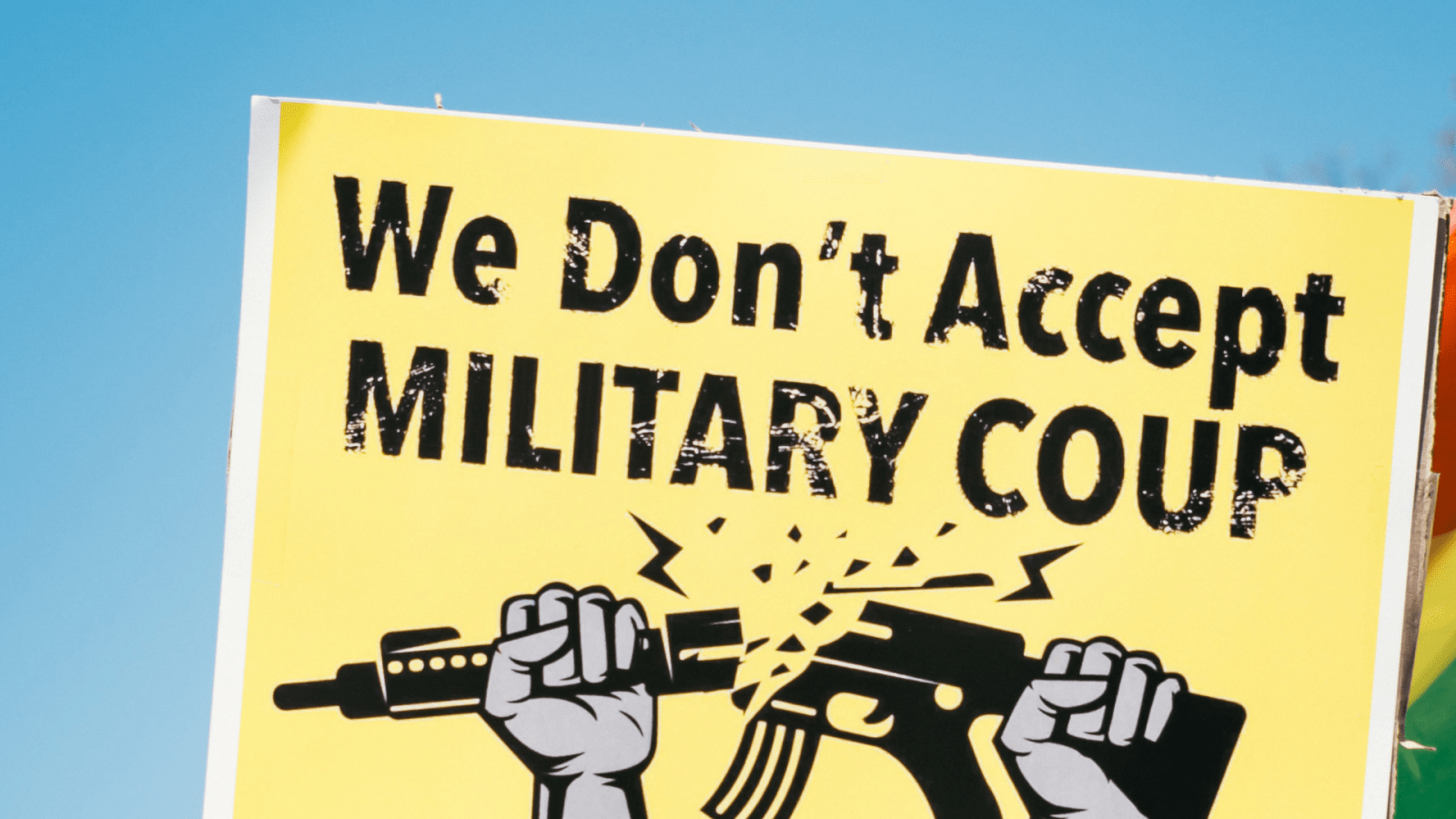 "poster states ""we don't accept military coup"""