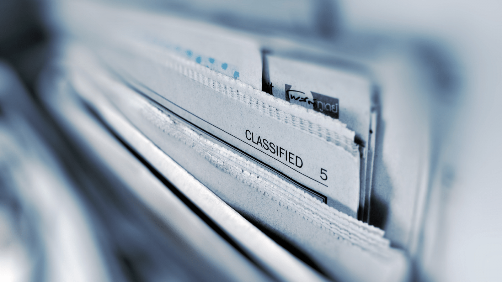 newspapers with 'classified' printed on one