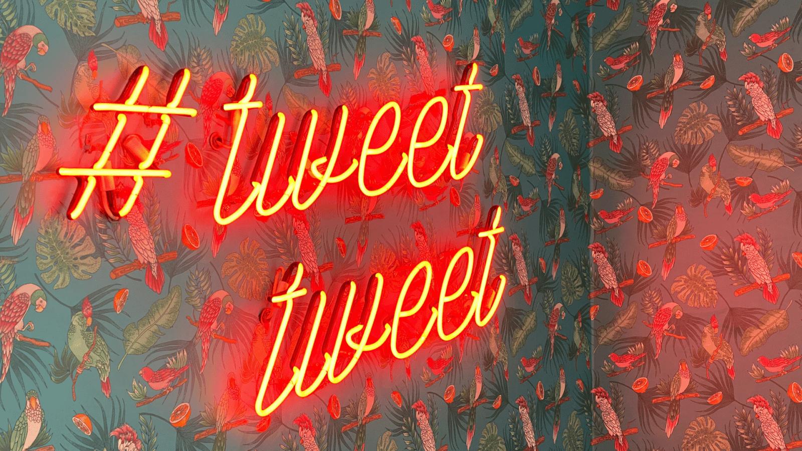 light up sign saying hashtag tweet tweet