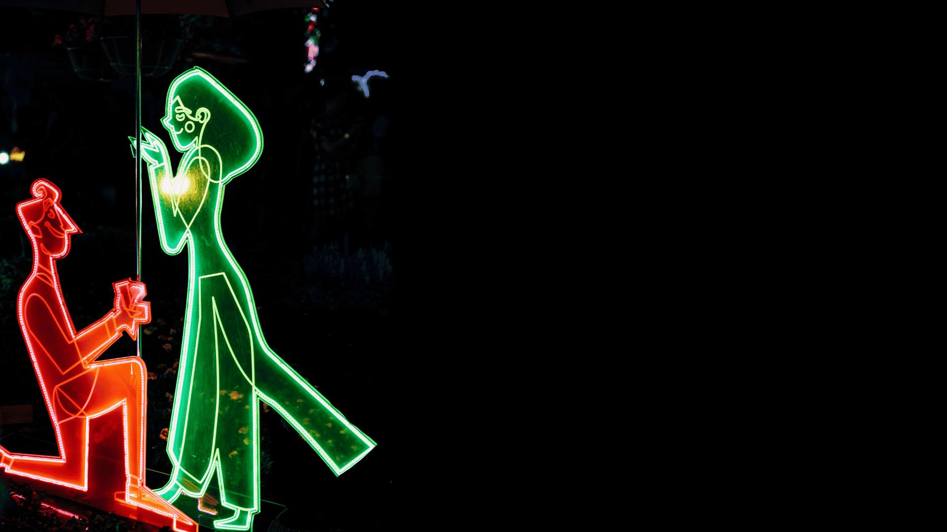 neon light man proposing to woman