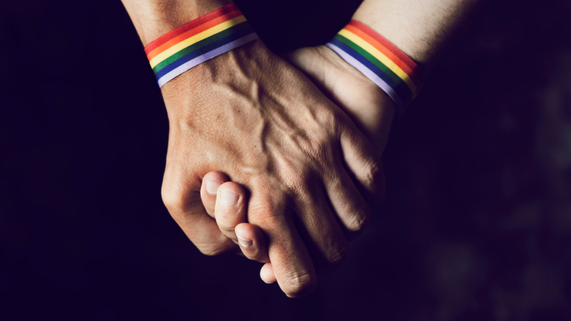 holding hands with Pride wristbands