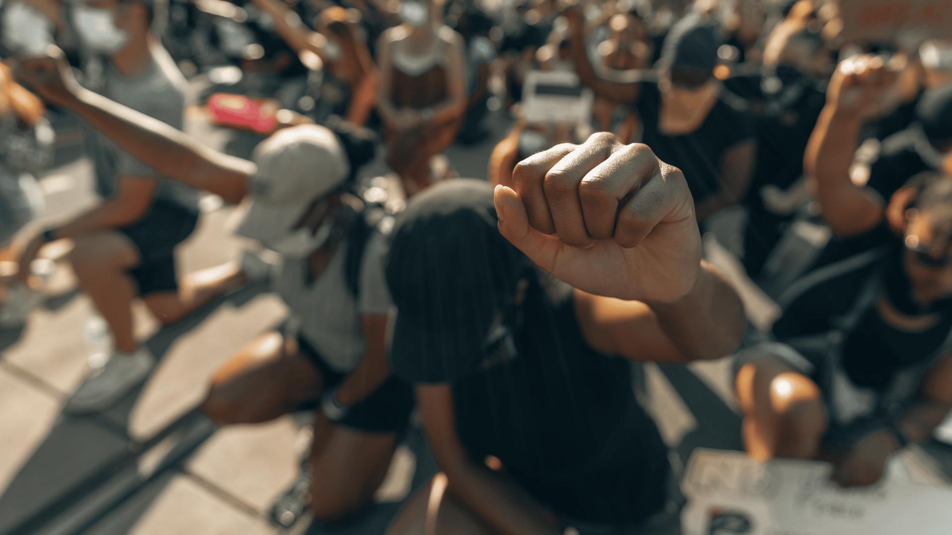 fist raised close to the camera