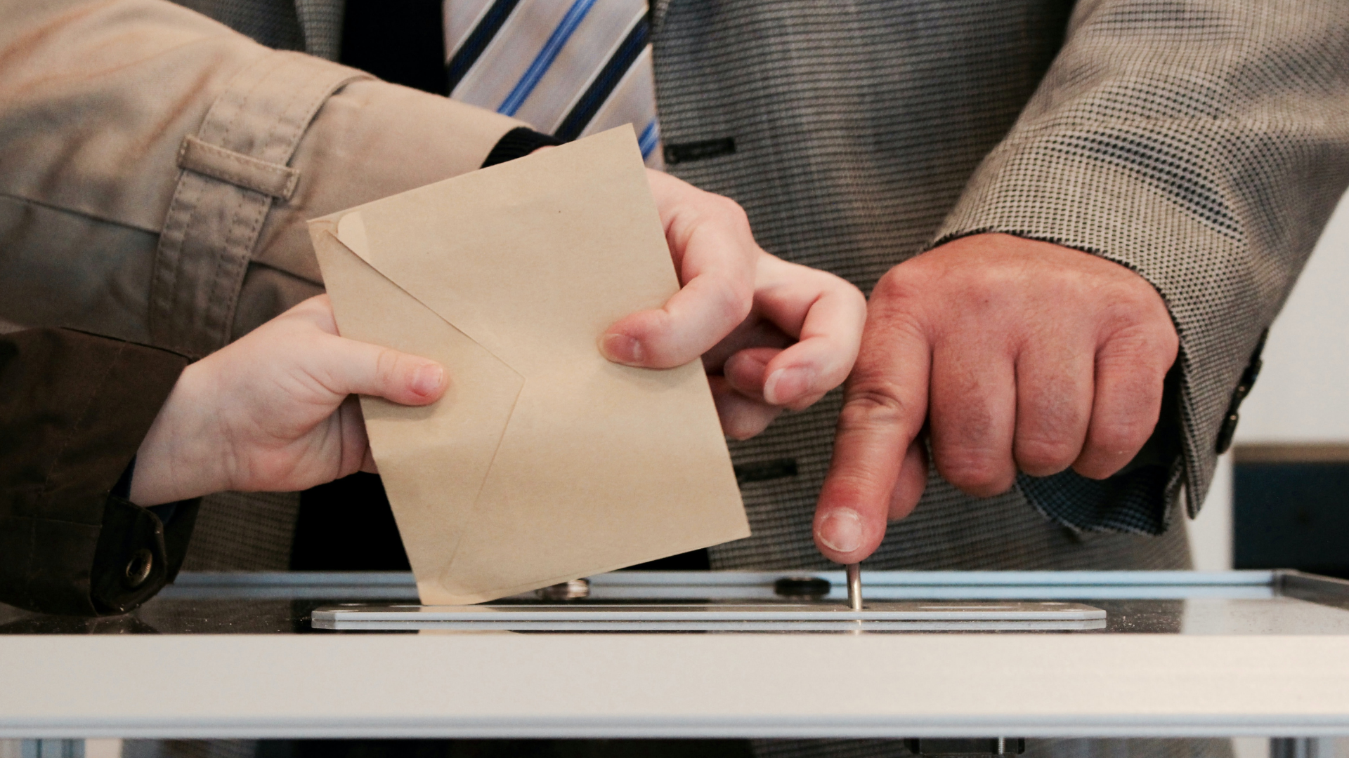 person casting their voting ballot
