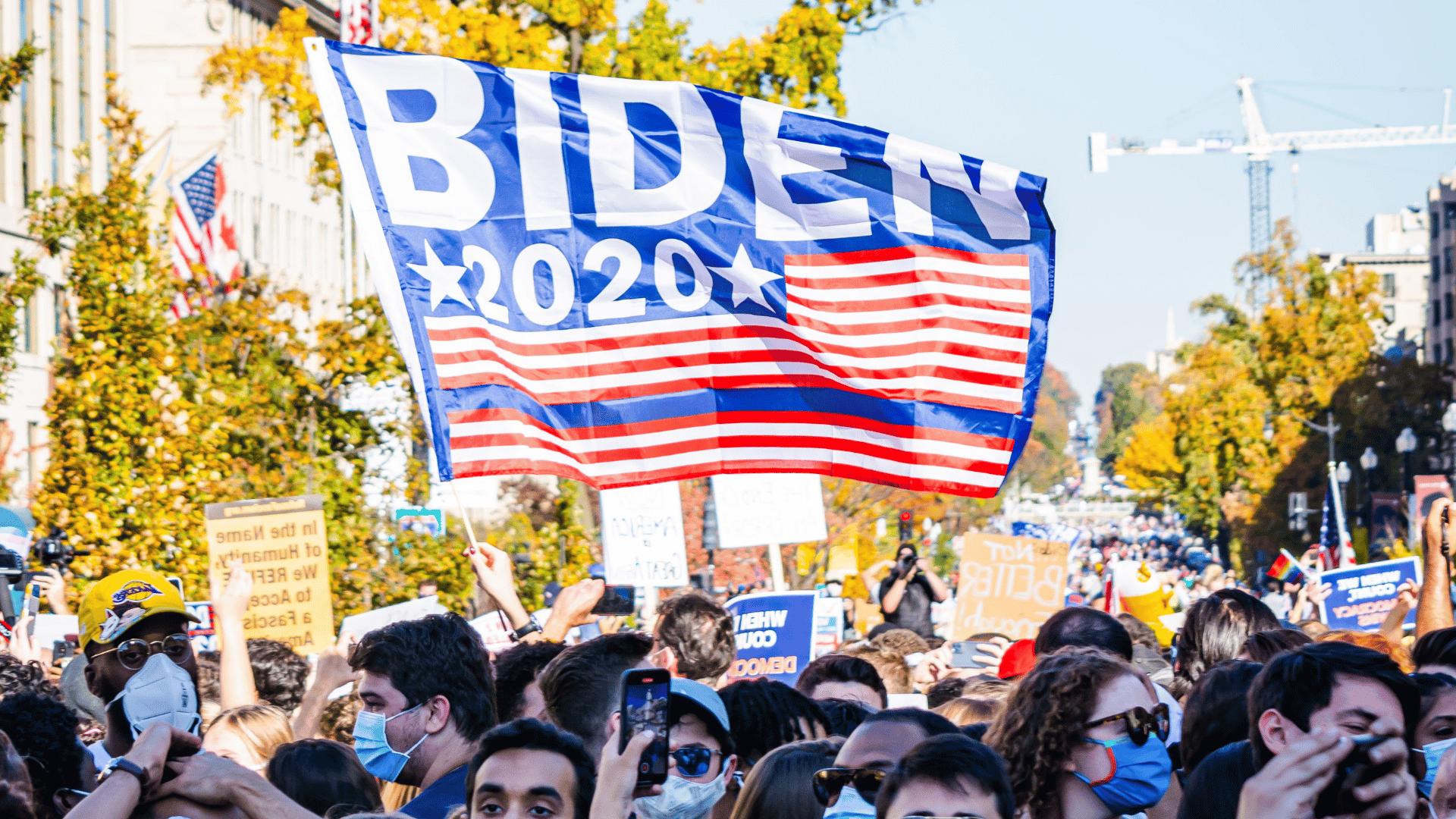 crowd holding a biden 2020 banner
